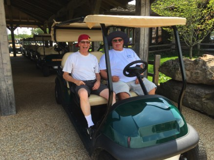 Garry and Terry ready for a cart ride at Table Rock Nature Preserve