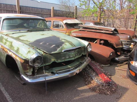 Old DeSoto and two Chryslers in corner of lot - waiting for the salvage man