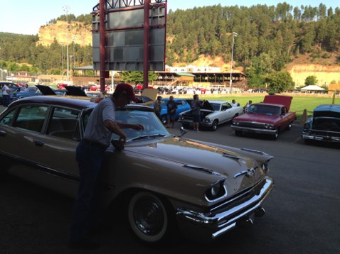 Early Saturday morning, day of car show - Garry shining his DeSoto