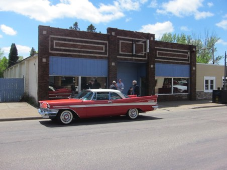"57 New Yorker outside ""Old Chrysler Museum"" in Isanti"