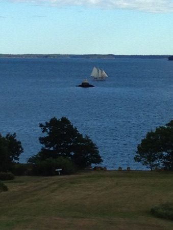 Sailing ship passing by the tiny island